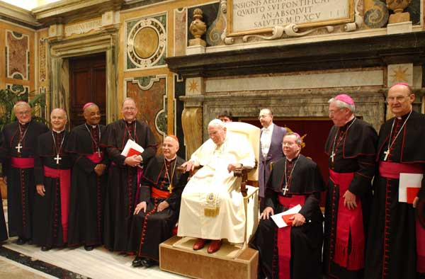 Cardinal Francis George, Archbishop of the Archdiocese of Chicago, sitting at right of Pope John Paul II, with other US prelates pose for a group photo during a meeting at the Vatican, on Friday, May 28, 2004 file photo.   <span class=meta>( &#40;AP Photo&#47;Osservatore Romano&#41;)</span>